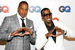 Rappers Jay-Z and  Kanye West make the 'pyramid sign' at a GQ anniversary party. Is that signal a nod to  the Illuminati?