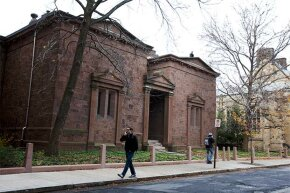 Students walk by the Skull and Bones Society building at Yale University in 2012.