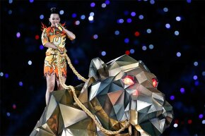 Singer Katy Perry performs an 'Illuminati-themed' show during half-time at Super Bowl XLIX, 2015.
