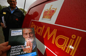 A postal worker holds up a leaflet giving information about swine flu in Cromarty, Scotland, on May 5, 2009. The government distributed leaflets to all U.K. households giving information about swine flu and advice on how to prevent its spread.