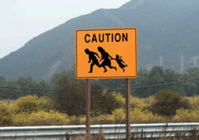 Signs like this one can be found near the U.S.-Mexico border, warning drivers to watch for illegal immigrants running across the highway.