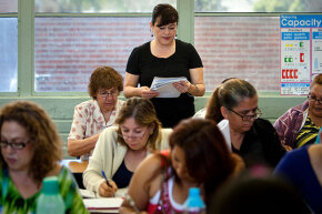 Teacher Cynthia Ontiveros helps students with a speech lesson during an ESL (English as a Second Language) class at Azusa Adult School in Glendora, California in 2013.