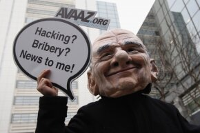 A protestor dressed as Rupert Murdoch during a February 2012 protest in London, England.