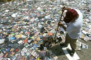 In a symbolic event, Peruvian officials ordered 250,000 pirated CDs, DVDs and software disks destroyed.