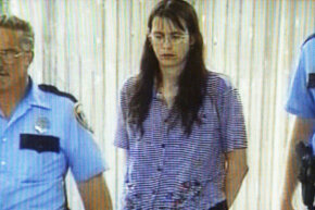 Andrea Yates being escorted into a police station after the drowning of her five children.