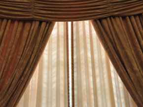 Insulated curtains can help lower your heating and cooling costs. See more pictures of green living.