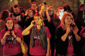 Videos with important messages can go viral too. Here, supporters watch a projection from Invisible Children's Kony 2012 video campaign. The nonprofit group wants Ugandan warlord Joseph Kony captured and the video got 100 million views in six days.