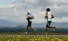 Cameron Brown from New Zealand leads Ainalar Juhanson from Estonia during the running leg of the Ironman New Zealand held at Lake Taupo.