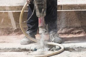 Jackhammers can kick up a lot of fine particulate, so wearing a face mask and wetting the work area are good ideas.