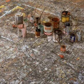A view of the paint-splattered floor of an art studio used by artist Jackson Pollock