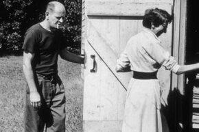 Pollock and his wife Lee Krasner enter the barn door of their Springs studio.