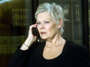 "Dame Judi Dench as the newest ""M"" in the 2006 film ""Casino Royale."""