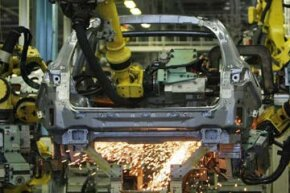 Robots assemble parts at Nissan's Tochigi plant in Kaminokawa, Japan. The plant produces models such as the Infiniti and the GT-R supercar as well the latest Fuga.