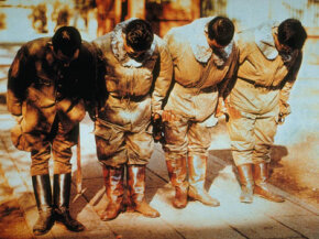 A group of Japanese kamikaze pilots bow during a ceremony in 1945.