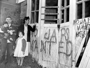A Japanese family returns home to find their garage vandalized with graffiti and broken windows in Seattle, on May 10, 1945.