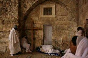 Ethiopian Christian pilgrims sleep outside the Church of the Holy Sepulcher in Jerusalem