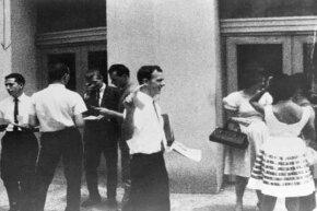 Lee Harvey Oswald is seen distributing pro-Cuba flyers on the streets of New Orleans, La. in 1962.