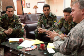 Bill Doan, a project manager with the U.S. Army Corps of Engineers, speaks to a group of soldiers who are interning with the organization for six months.