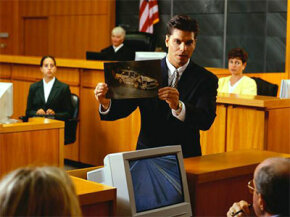 A lawyer presents evidence to a jury.