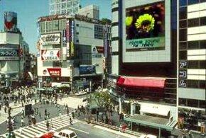 An outdoor jumbo TV screen in Shibuya, Japan