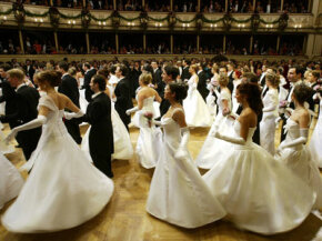 Debutantes glide across the floor at the Vienna Opera Ball in February 2004. Junior League began with a debutante's hopeful vision for a better society.