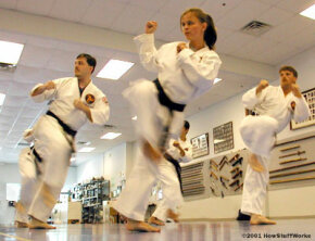 Karatekas practicing at Karate International of Raleigh. While the instructors at this school don't teach Zen Buddhism, they do help their students achieve inner focus and enlightenment. The spiritual elements of karate complement most major religions.