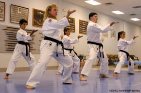 Advanced karatekas at Karate International of Raleigh practice their stances. (L-R) Michael Tuso is a first-degree black belt, Kathy Olevsky is a sixth-degree black belt, John Elliott is a third-degree brown belt, Tony Letourneau is a fourth-degree black belt and Mindy Mayernik is a third-degree black belt.