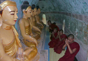 Novice Buddhist monks pray in Myanmar. See more religion pictures.