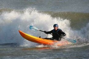 Image Gallery: Surfing The surf kayak's design lets wave riders reach high speeds, even without the help of large waves. See more pictures of surfing.