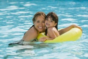 Image Gallery: Parenting How can you let you kids have fun at the pool and make sure they're safe at the same time? See more parenting pictures.