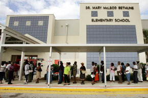 "Voters wait in line in Riviera Beach, Florida in 2004. Before the 2000 presidential election, state officials had ""ineligible"" people deleted off the voter registration rolls — which disproportionately affected black voters."