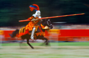 A knight on horseback at a tournament in Bavaria, Germany. See the most famous knight in these pictures of King Arthur.