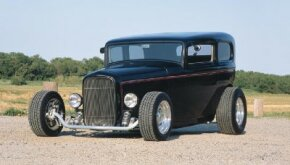 Sharon Kolmos chose a chopped, fenderless 1932 Ford Tudor body for her sedan. See more hot rod pictures.