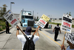 A truck driven by a replacement worker moves Coca-Cola soft drinks to market during a 2005 strike in California.