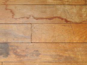 Unlike this wood floor, laminate floors are resistant to stains and damage.