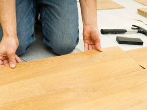 Laminate floors are installed over an underlayment using tongue-and-groove joints.