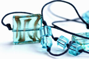 Lampworking can be used to create smaller works, such as these beads, and larger pieces too.