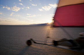 To stop a speeding land sailboat, you turn into the wind.