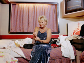 This middle-aged woman in her cruise ship cabin fits the profile and may end up wobbly back on land.