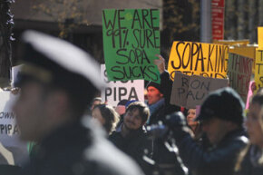Protesters show their disdain for the Stop Online Piracy Act (SOPA) and the Protect IP Act (PIPA) on January 18, 2012 in New York City.