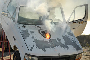 The Lockheed Martin ATHENA laser weapon system defeats a truck target by disabling the engine, demonstrating its military effectiveness against enemy ground vehicles.