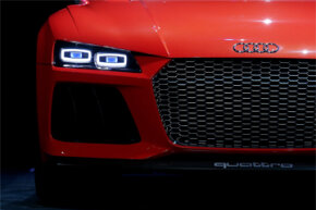 The Audi Sport quattro laserlight concept car sits on stage during a keynote address by Rupert Stadler, Chairman of the Board of Management of Audi AG, at the 2014 International CES in Las Vegas, Nevada.