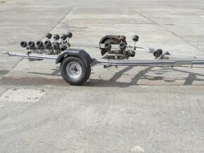 The rollers on this boat trailer make it easier to launch and retrieve a boat without damaging it.
