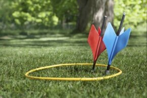 They look innocuous enough parked in the ground, but catch one of those vintage and outlawed (in the U.S.) lawn darts in the noggin, and you might be singing a different tune. Actually, you might not be singing at all.