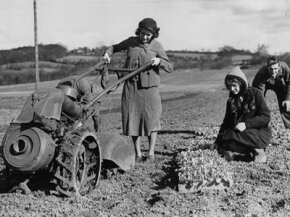 """Back in my day, our tillers were large an unwieldy. And we worked in dresses and liked it!"""