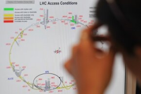 A scientist puzzles over a map of access conditions at the Large Hadron Collider just a few days before the massive underground laboratory first turned on in September 2008.