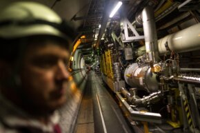 Sometimes the machine charged with facilitating head-spinning discoveries needs a little downtime. Here, a maintenance worker inspects the LHC tunnel on Nov. 19, 2013.