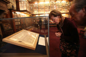 A visitor gazes upon an original copy of the Magna Carta at New York's Morgan Library and Museum, in April 2010.