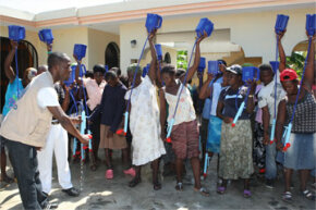 October 2010: Residents at the Croix Des Bouquets camp north of Port Au Prince, Haiti receiving training to use LifeStraw Family. See more green science pictures.