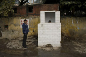 A man waits to use a public restroom in New Delhi, India. Twenty five percent of New Delhi's 16 million residents have no access to running water.